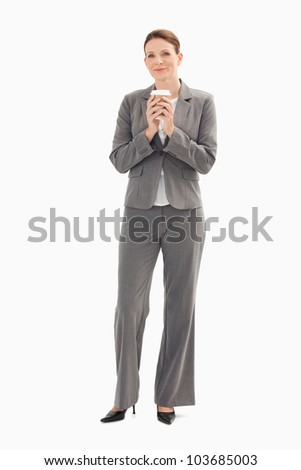 A businesswoman is holding a cup of coffee with her both hands Stock photo © wavebreak_media