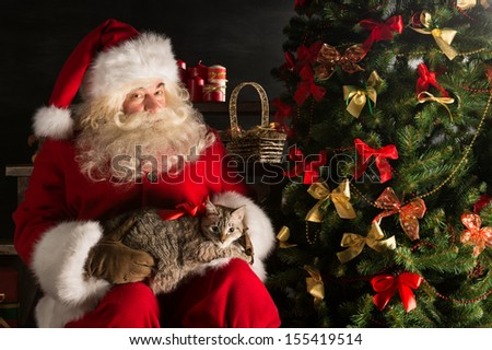 santa claus making a most wanted gift to a child placing cute ca stock photo © hasloo