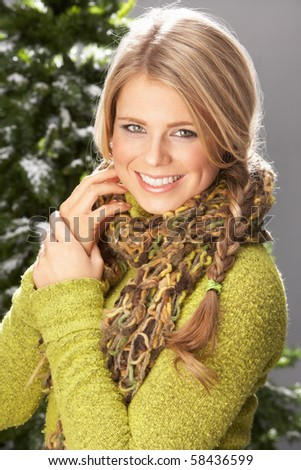 Fashionable Woman Wearing Knitwear In Studio In Front Of Christm Stock photo © monkey_business