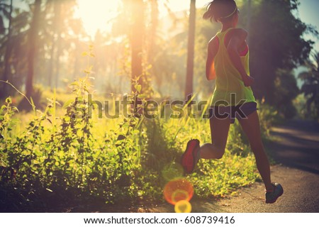 young beautiful woman running on the mountain trail in the morning stock photo © maxpro