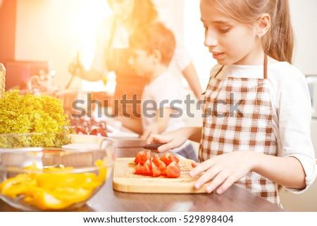 Girl cutting tomatoes Stock photo © gemenacom