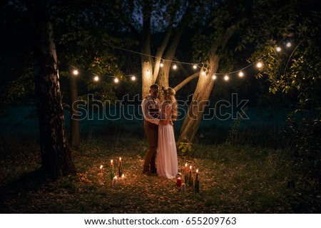 Young girl in the image of a bride with lighted candles in their Stock photo © vlad_star