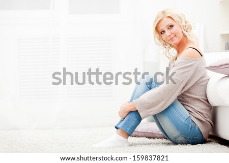 Smiling teen girl in colorful cloths lying on floor and relaxing Stock photo © deandrobot