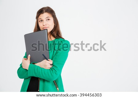 thoughtful attractive woman in green jacket holding folders and thinking stock photo © deandrobot