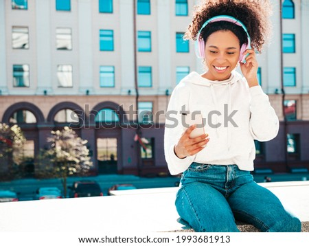 Sexy young African woman posing at sunset Stock photo © dash