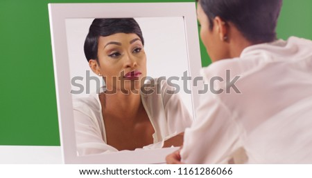 Thoughtful lovely african american young woman with makeup brushes stock photo © deandrobot