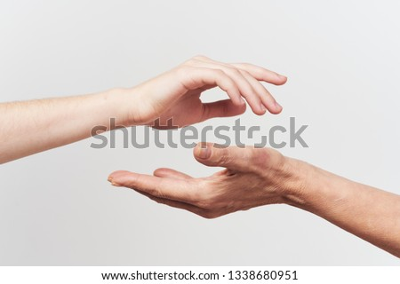 Old and young holding hands of each other, isolated on a white  Stock photo © OlgaYakovenko