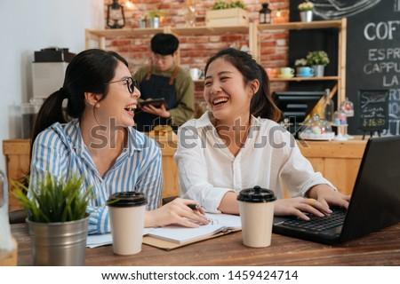 два коллеги служба используя ноутбук фотография Сток-фото © deandrobot