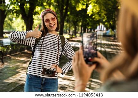 женщину · рюкзак · фото · смартфон · красный · Hat - Сток-фото © vlad_star