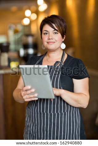 Portrait of smiling waitress holding tablet while standing by young customers Stock photo © wavebreak_media