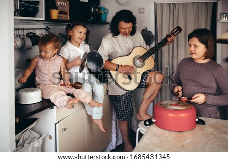 Father and daughter playing with guitar and utensils in living room Stock photo © wavebreak_media