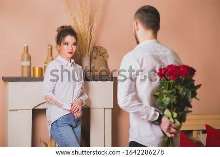 Woman looking for flowers behind man's back against white background Stock photo © IS2