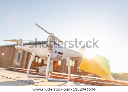 Drone Quadcopter Next to Hard Hat Helmet At Construction Site wi Stock photo © feverpitch
