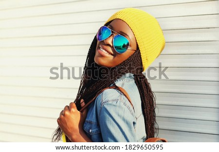 image of cheerful woman 20s in casual wear and sunglasses lookin stock photo © deandrobot