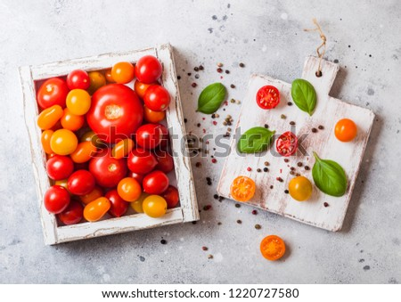 Organic Tomatoes with basil in vintage wooden box on stone kitchen table background. San Marzano, or Stock photo © DenisMArt