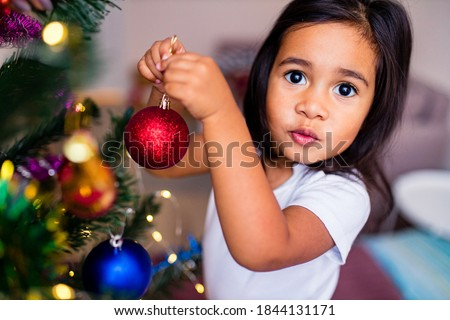 Cute Mixed Race Baby Girl Christmas Portrait With Family Behind  Stock photo © feverpitch