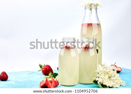 Kombucha tea with elderflower and strawberry on blue background. . Stock photo © Illia