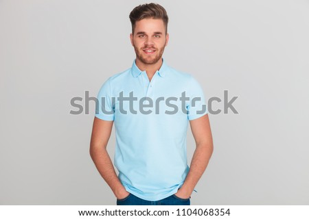 attractive casual man wearing blue polo short holds blue files Stock photo © feedough