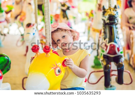 Cute little boy enjoying in funfair and riding on colorful carousel house Stock photo © galitskaya