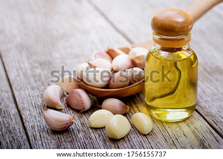 Garlic with essential oil in a bottle Stock photo © bdspn