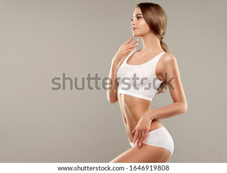 Perfect slim toned young body of the girl . An example of sports , fitness or plastic surgery and ae Stock photo © serdechny