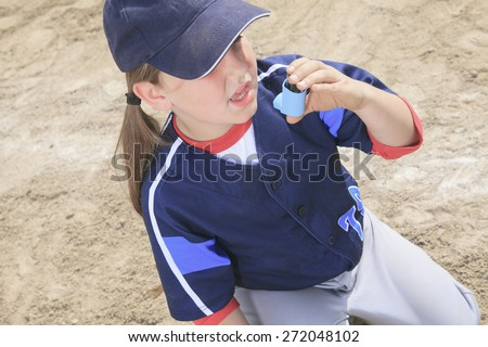 A baseball player having a asthma crisis Stock photo © Lopolo