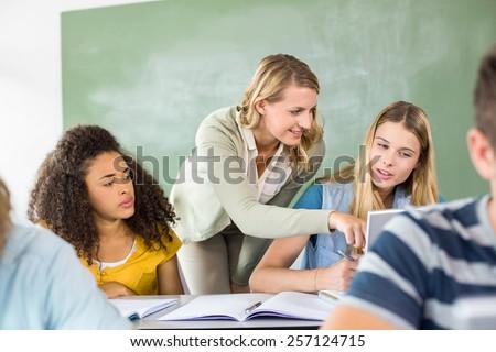 Elöl kilátás fiatal iskola tanár segít Stock fotó © wavebreak_media