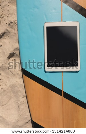 Digitale tablet surfboard strand zonneschijn Stockfoto © wavebreak_media