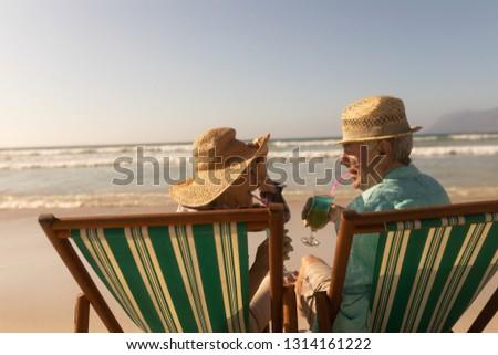 背面図 リラックス 太陽 手をつない ビーチ ストックフォト © wavebreak_media