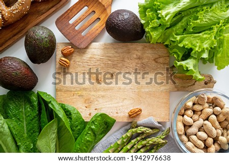 Selection of superfoods around cutting board on white background.  Stock photo © Illia