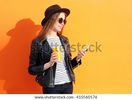 Hands of young female millennial with smartphone and drink looking through promo Stock photo © pressmaster