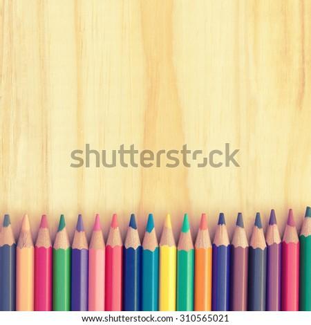 Colored pencils on a wooden board Stock photo © galitskaya