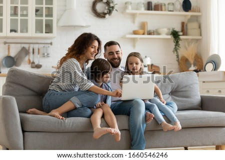 Happy lovely family in home kitchen, father embraces mother with love, little girl looks in bowl, ob Stock photo © vkstudio