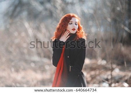 Stock photo: A female student with bright long yellow hair walks around the city