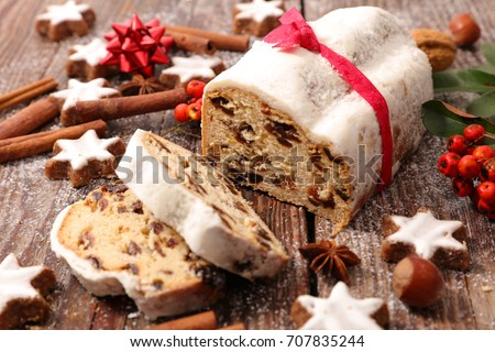 Sliced stollen with christmas decoration, a traditional German fruit cake Stock photo © Melnyk