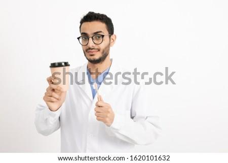 Jovem dentista óculos vidro café Foto stock © pressmaster