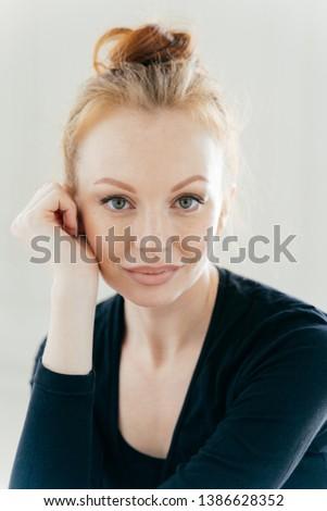 Vertical close up shot of redhead female ballerina, looks confidently at camera, has makeup, wears b Stock photo © vkstudio