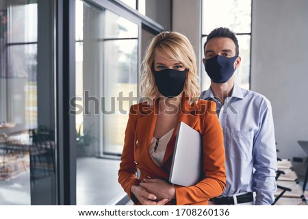 Front view of young Caucasian blonde businesswoman talking on mobile phone in the modern office Stock photo © wavebreak_media