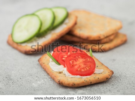 Various healthy crackers with cream and tomato on light kitchen table background. Macro Stock photo © DenisMArt
