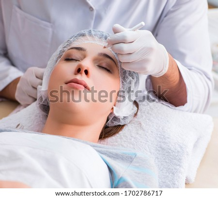 Woman visiting doctor cosmetologyst in beauty concept  Stock photo © Elnur