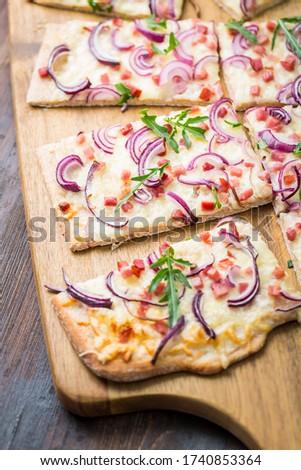 Flammkuchen - Traditional French dish tarte flambee cream cheese, bacon and onions Stock photo © brebca