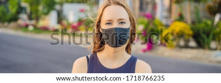 Fashionable black medical mask with filter in the city. Coronavirus 2019-ncov epidemic concept. Woma Stock photo © galitskaya