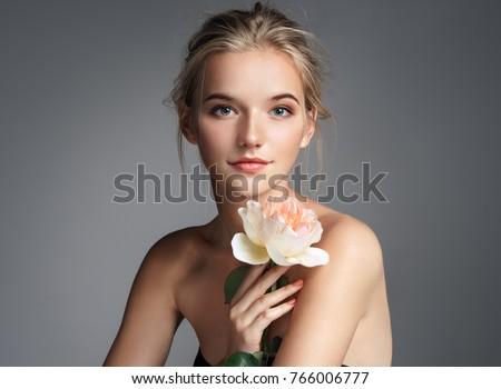 beautiful girl with flower stock photo © petrmalyshev