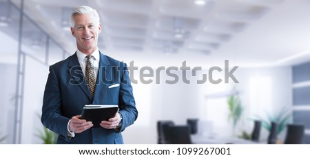 Portrait of confident businessman at his office standing near em Stock photo © HASLOO