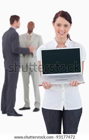 fiatal · női · bemutat · laptop · képernyő · fehér - stock fotó © wavebreak_media