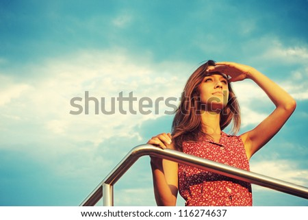 Young and beautiful woman in sunset light looking far away. Phot Stock photo © HASLOO