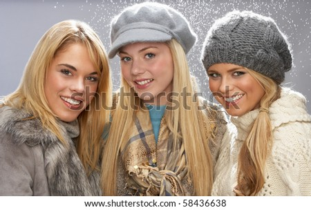 Two Fashionable Teenage Girls Wearing Cap And Knitwear In Studio Stock photo © monkey_business