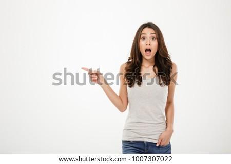 megrémült · ázsiai · fiatal · nő · mutat · izolált · fehér - stock fotó © bmonteny