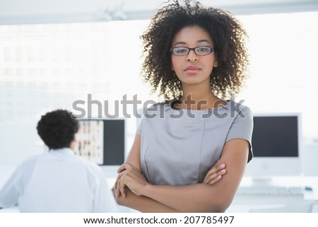 Portrait of a young businesswoman in glasses reading something Stock photo © deandrobot