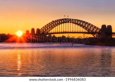 Sunrise behind Sydney Harbour Bridge from Balmain Stock photo © lovleah